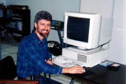 Carey with computer, 1980s